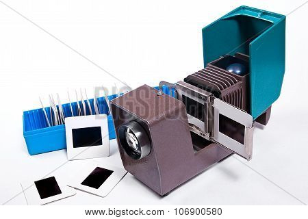 Old Projector For Displaying Of Slides. Slides In Blue Box On White Background.