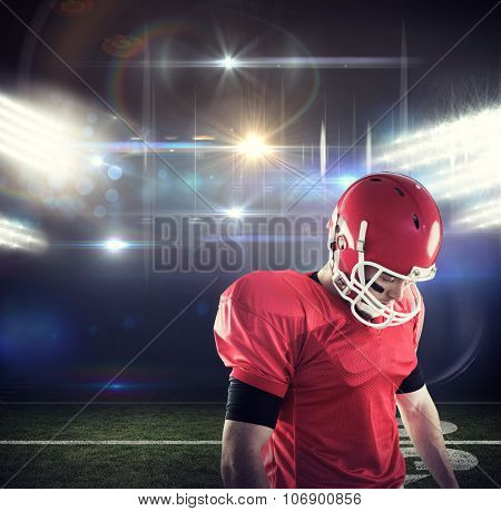 American football player focusing against american football arena