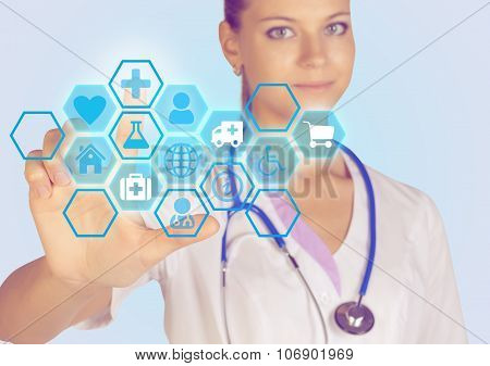Young woman doctor presses on the icon index finger