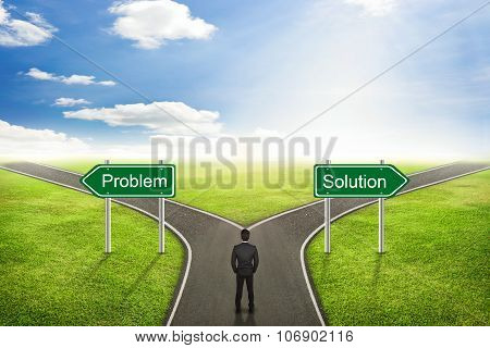 Businessman Concept, Choose Between Problem Or Solution Road The Correct Way.