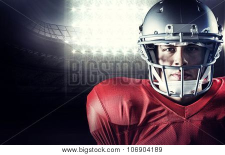 Close-up portrait of determined sportsman against american football arena
