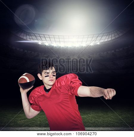American football player throwing a ball against american football arena