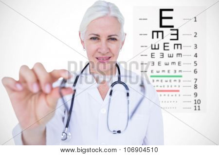Smiling female doctor presenting eye glasses against eye test