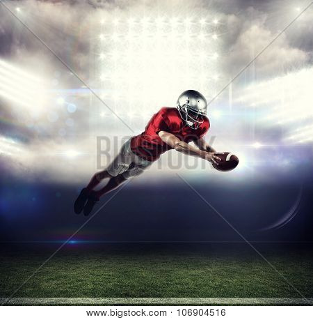 American football player scoring a touchdown against sports pitch