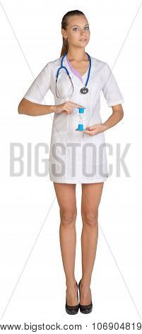 Woman doctor holding fingers hourglass. White background