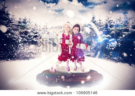 Festive child in snow globe against snow scene