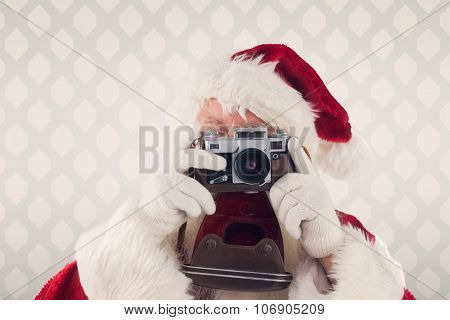 Santa is taking a picture against room with wooden floor