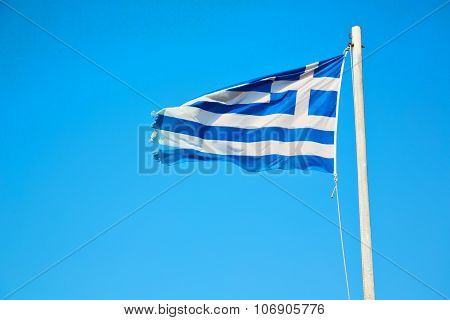 Waving In The Blue Sky And Flagpole