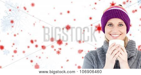 Smiling woman in a grey pullover against white background against snowflake pattern