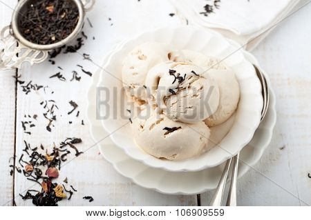 Ice cream with Earl grey tea flavor. White ceramic bowl