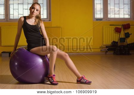 Fit Woman Exercising With A Fit Ball