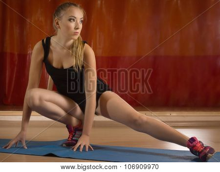 Fit Girl Stretching The Muscles Of Her Legs