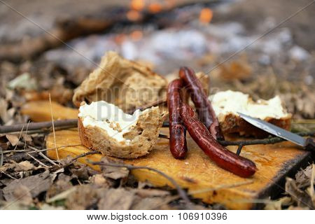 Grilled sausages in the wood closeup