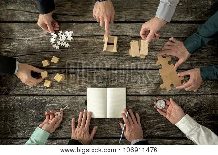 Eight Businessmen Planning A Strategy In Business Advancement