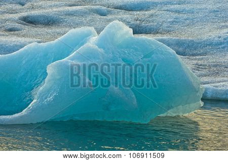 Melting of icebergs at Jokulsarlon glacier lagoon at sunset