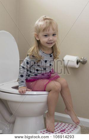 Cute little girl potty training
