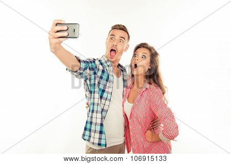 Funny Couple In Love Making Selfie Photo With Smartphone