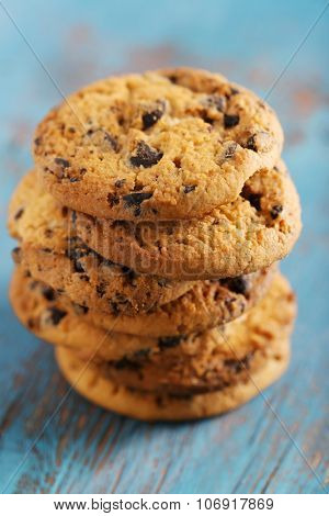 Close up focus view on cookies with chocolate crumbs on blue wooden table