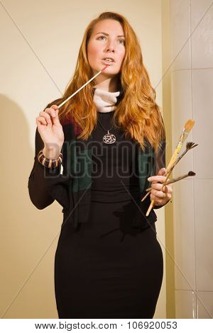Pretty Woman Painter With Brushes In A Luxurious Interior