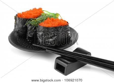 Sushi with tobiko and chopsticks isolated on white