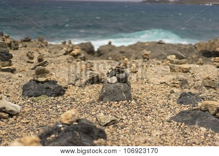Stone Piles Near A Stormy Sea