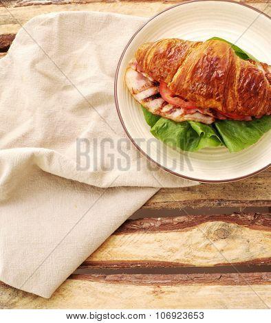 Food. Delicious BLT sandwich out of croissant