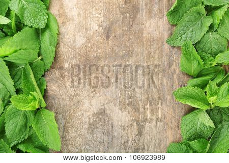 Frame of fresh mint on wooden background