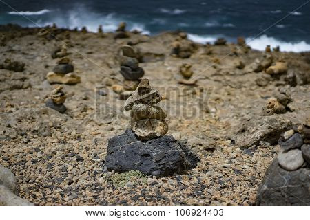 Stone Piles In Front Of A Stormy Sea