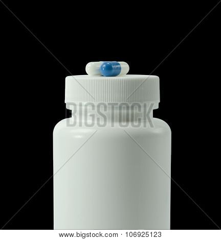 Two Pills Of A White And Blue Colors With White Jar