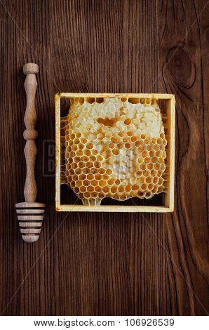 Honeycombs With A Wooden Dipper