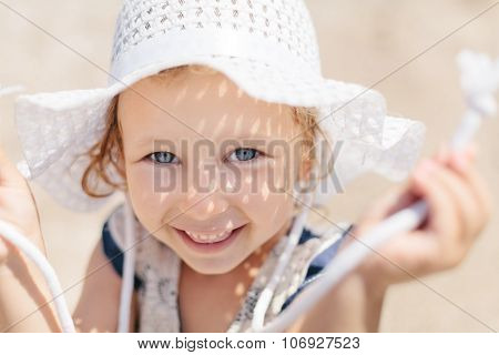 Adorable Happy Smiling Little Girl With Curly Hair On Beach Vacation