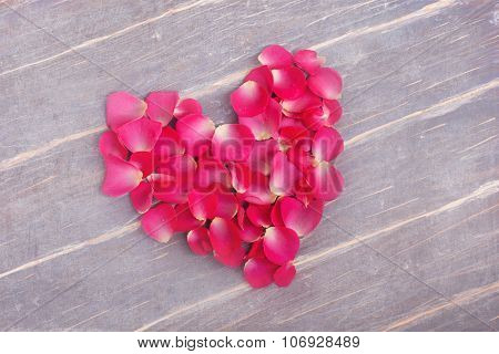 Heart Fromm Flowers On The Wooden Background