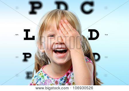 Girl Having Fun At Vision Test.