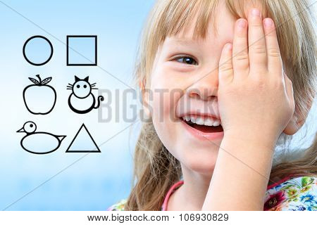 Kid Testing Vision With Symbols.