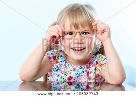 Little Girl Testing New Glasses.