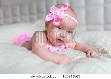 Baby girl dressed up in little mermaid costume