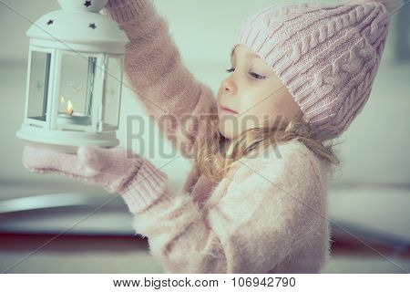 Portrait Of Ptetty Little Girl With Flashlight