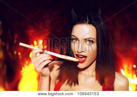 Sexy Woman With Red Lips Taste Meal In Hell