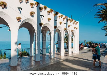 People walking near Balcon de Europa in resort town of Nerja in