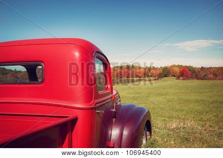 Old Red Farm Truck Against Apple Orchard And Autumn Landscape