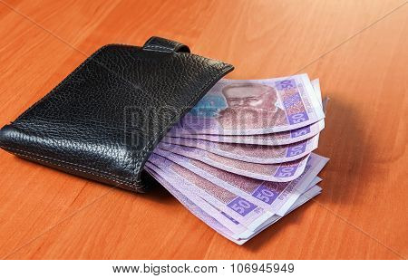 Fifty Ukrainian Hryvnia Banknotes In Black Purse