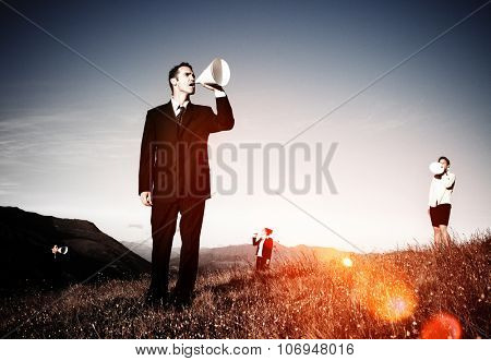 Business People Shouting Through Paper Megaphone Concept