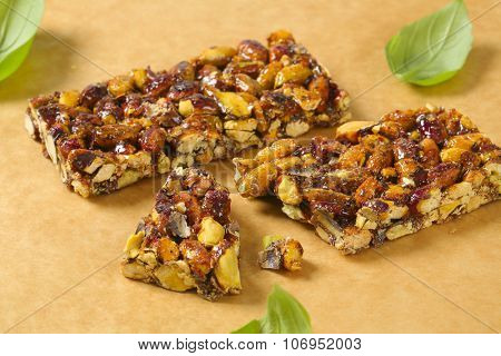 close up of nut snack bars on wooden cutting board