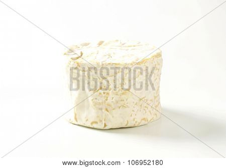 soft white rind cheese on white background