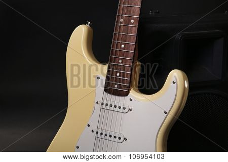Electric guitar with musical equipment on dark background