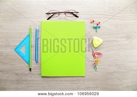 Colourful stationery on grey wooden background