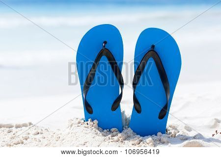 Color Slippers On Beach