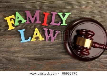 A gavel and colourful letters regarding child-custody and family-law concept