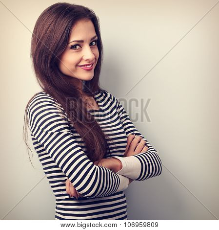 Beautiful Charming Young Casual Woman With Folded Hands Looking Happy. Vintage Portrait
