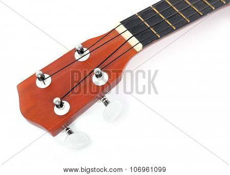 Close-up head part of the Hawaiian acoustic guitar isolated on white